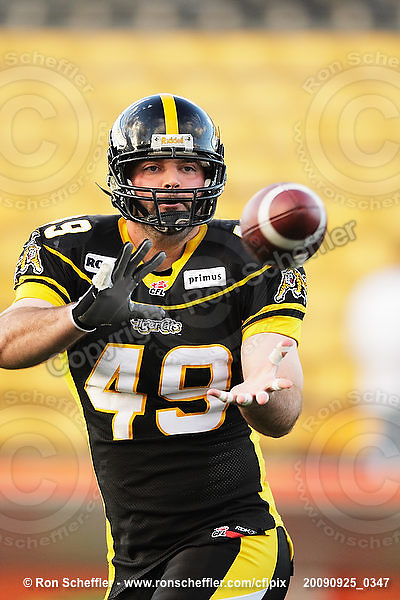 September 25, 2009; Hamilton, ON, CAN; Hamilton Tiger-Cats fullback Robert Pavlovic (49). CFL football: Montreal Alouettes vs. Hamilton Tiger-Cats at Ivor Wynne Stadium. The Alouettes defeated the Tiger-Cats 42-8. Mandatory Credit: Ron Scheffler. Copyright (c) 2009 Ron Scheffler.