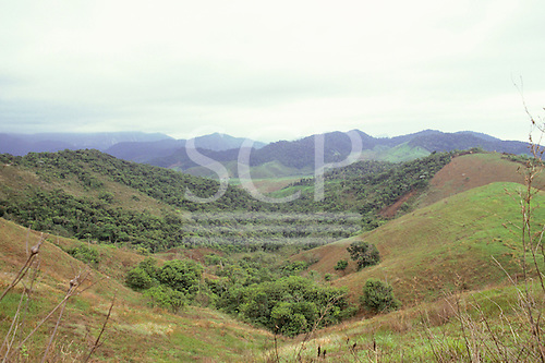 Rio de Janeiro State, Brazil. Typical hills of Atlantic Rainforest (Mata Atlantica) area which have been cleared for farming.