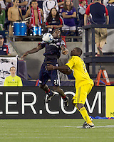 New England Revolution midfielder Shalrie Joseph (21) chest trap as Columbus Crew defender Andy Iro (6) defends. The New England Revolution tied Columbus Crew, 2-2, at Gillette Stadium on September 25, 2010.
