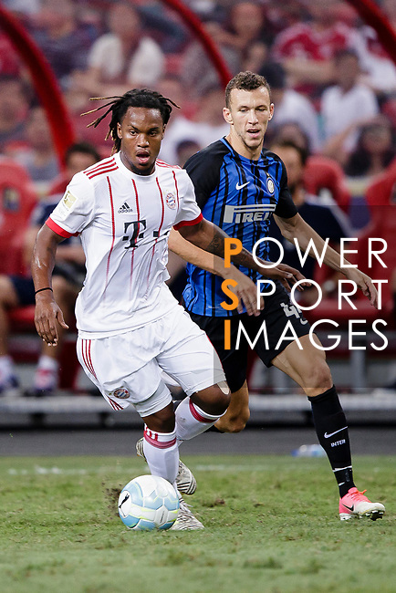 Bayern Munich Midfielder Renato Sanches (L) dribbles FC Internazionale Forward Ivan Perisic (R) during the International Champions Cup match between FC Bayern and FC Internazionale at National Stadium on July 27, 2017 in Singapore. Photo by Marcio Rodrigo Machado / Power Sport Images