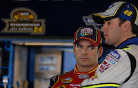 Mar 31, 2007; Martinsville, VA, USA; Nascar Nextel Cup Series driver Jeff Gordon (24) talks with teammate Jimmie Johnson (48) during practice for the Goody's Cool Orange 500 at Martinsville Speedway. Martinsville marks the second race for the new car of tomorrow. Mandatory Credit: Mark J. Rebilas