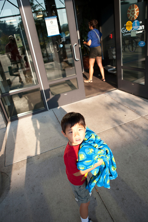 Trusty frog blanket in hand, Holden Miller, 4, arrives for his first day of preschool at the Goodman Community Center  in Madison, Wis., on Sept. 1, 2011.