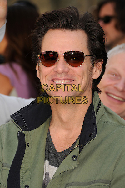 Jim Carrey.TCM Classic Film Festival 2013 - Jane Fonda Handprint and Footprint Ceremony held at the TCL Chinese Theatre, Hollywood Walk of Fame, Hollywood, California, USA, 27th April 2013..portrait headshot smiling aviators green khaki jacket sunglasses .CAP/ADM/BP.©Byron Purvis/AdMedia/Capital Pictures