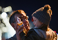 """NWA Democrat-Gazette/CHARLIE KAIJO Dean Stepp of Springdale holds Caroline Moseley, 3, of Lowell, Saturday, November 30, 2019 during an annual Christmas parade along Emma Ave. in Springdale.<br /> <br /> Floats, bands and Santa greeted visitors for the 23rd annual Christmas parade. This year's theme was """"Christmas Vacation"""". The parade started at Parsons Stadium and headed west on Emma Avenue, concluding at Harris Street."""