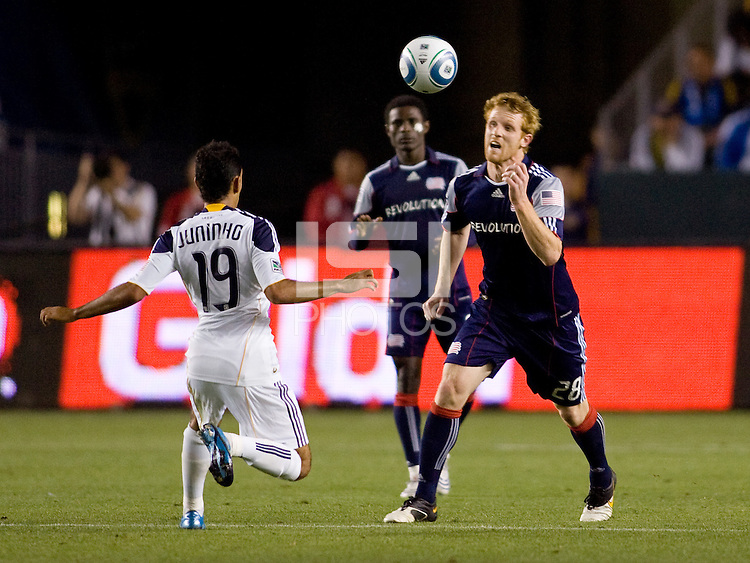 New England midfielder Pat Phelan battles LA Galaxy midfielder Juninho. The LA Galaxy defeated the New England Revolution 1-0 at Home Depot Center stadium in Carson, California on Saturday evening March 27, 2010.  .