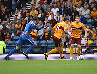 Steven Jennings on the ball with Steven Hammell there to assist