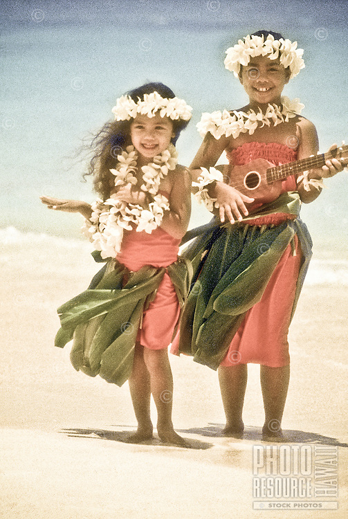 Young keikis (children) dance hula and play ukulele at beach