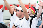 09 June 2006: German fans sing as they head into Munich from the main train station on their way to the game. Germany played Costa Rica at the Allianz Arena in Munich, Germany in the opening match, a Group A first round game, of the 2006 FIFA World Cup.