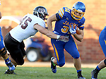 BROOKINGS, SD - OCTOBER 11:  Zach Zenner #31 from South Dakota State tries to slip the grasp of Christian Hoffmann #45 from Missouri State in the first half of their game Saturday evening at Coughlin Alumni Stadium in Brookings. (Photo/Dave Eggen/Inertia)