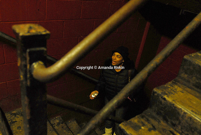 "Octavia Sanders, 32, a public housing resident, in the stairwell at a Cabrini Green high rise on the corner of Halsted and Division Streets at 1230 N. Burling in Chicago, Illinois on December 18, 2007.  Sanders told Grant Newburger, 50, a supporter of Bob Avakian's Revolutionary Communist Party, she was upset by an early morning raid in the building and her 12 year old son being ""Tasered"" by a police sergeant in November."