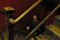 """Octavia Sanders, 32, a public housing resident, in the stairwell at a Cabrini Green high rise on the corner of Halsted and Division Streets at 1230 N. Burling in Chicago, Illinois on December 18, 2007.  Sanders told Grant Newburger, 50, a supporter of Bob Avakian's Revolutionary Communist Party, she was upset by an early morning raid in the building and her 12 year old son being """"Tasered"""" by a police sergeant in November."""