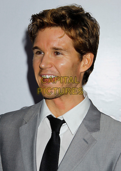 RYAN KWANTEN .Attending Calvin Klein Collection and LOS ANGELES NOMADIC DIVISION present a celebration of L.A. Arts Month held at the Calvin Klein Store, Los Angeles, CA, USA, 28th January 2010..portrait headshot mouth open profile  grey gray black tie  .CAP/ADM/MJ.©Michael Jade/Admedia/Capital Pictures
