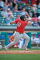 Rochester Red Wings catcher Juan Graterol (50) follows through on a swing during a game against the Indianapolis Indians on July 24, 2018 at Victory Field in Indianapolis, Indiana.  Rochester defeated Indianapolis 2-0.  (Mike Janes/Four Seam Images)