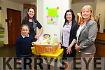 Niamh Moran from Portmagee was AIB Cahersiveen winner of the Easter Hamper pictured here on Monday picking up her prize with l-r; Niamh O'Sullivan, Angie Donoghue & Mary Healy(Manager).