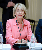 United States Secretary of Education Betsy DeVos listens as US President Donald Trump speaks during a strategic and policy discussion with CEOs in the State Department Library in the Eisenhower Executive Office Building (EEOB) in Washington, DC, April 11, 2017.<br /> Credit: Olivier Douliery / Pool via CNP