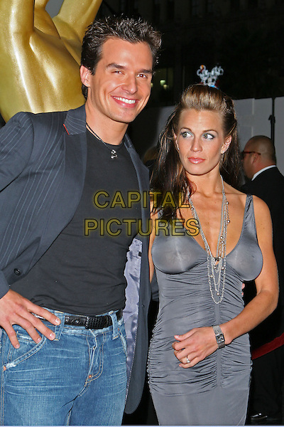 ANTONIO SABATO JR & GIRLFRIEND TRISTIN.2005 World Music Awards, held at the Kodak Theatre, Hollywood, CA..31st August 2005.half length black t-shirt silver grey gray dress couple .www.capitalpictures.com.sales@capitalpictures.com.© Capital Pictures.