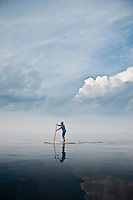 A female stand up paddler on Lake Superior near Marquette Michigan.