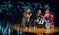NWA Democrat-Gazette/BEN GOFF @NWABENGOFF<br /> Cassandra Hernandez (left), Rogers High School FX Show Choir director, sings 'Hallelujah' with support from the choir and Rogers High School Orchestra, to Maggie Alexander, 4, and mother Kelly Alexander of Rogers Thursday, Feb. 8, 2018, during an event to surprise Maggie with her wish from Make-A-Wish Mid-South at Rogers High School. The Rogers High DECA Club and Make-A-Wish Mid-South surprised Maggie, who has been diagnosed with spinal muscular atrophy type II, with a seven-day trip to Disney World. Maggie and her family will leave for their trip in two weeks.