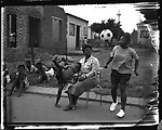 Aretha Tshabalala (20), with her mother and brother, Kwa-xuma Township, Soweto, South Africa, 1998