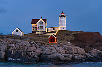 Nubble Lighthouse, as Cape Neddick Lighthouse is often called, is located on York Beach, Maine, USA, Atlantic Ocean. It is decorated with lights during the Christmas season.  It is automated and unmanned. Built in 1879.