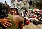 Two family members embrace after reuniting in the aftermath of Hurricane Katrina on Thursday, September 2, 2005.  (photo by Khampha Bouaphanh)
