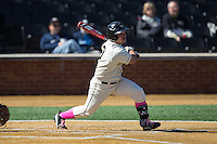 Joey Rodriguez (8) of the Wake Forest Demon Deacons follows through on his swing against the Virginia Tech Hokies at Wake Forest Baseball Park on March 7, 2015 in Winston-Salem, North Carolina.  The Hokies defeated the Demon Deacons 12-7 in game one of a double-header.   (Brian Westerholt/Four Seam Images)