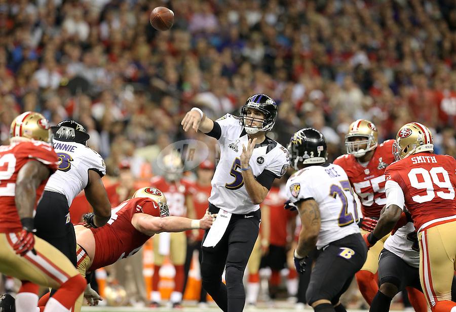 Feb 3, 2013; New Orleans, LA, USA; Baltimore Ravens quarterback Joe Flacco (5) throws a pass against the San Francisco 49ers in Super Bowl XLVII at the Mercedes-Benz Superdome. Mandatory Credit: Mark J. Rebilas-