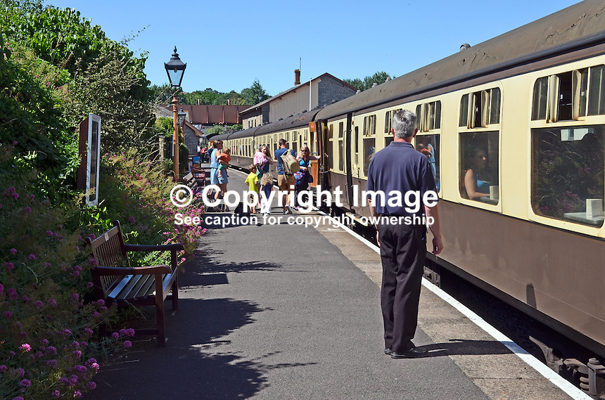 Passengers board train at Watchet station, West Somerset Railway, UK, July, 2014. The steam train runs between Minehead and Bishops Lydeard. 201407093453<br />