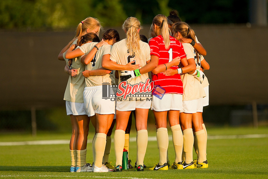 The Wake Forest Demon Deacons women's soccer team huddles up prior to their game against the UNC-Greensboro Spartans at Spry Soccer Stadium on August 24, 2012 in Winston-Salem, North Carolina.  The Spartans defeated the Demon Deacons 1-0.  (Brian Westerholt / Sports On Film)