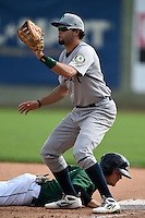 Beloit Snappers first baseman Michael Soto (5) waits for a throw as Justin Seager dives back to first during a game against the Clinton LumberKings on August 17, 2014 at Ashford University Field in Clinton, Iowa.  Clinton defeated Beloit 4-3.  (Mike Janes/Four Seam Images)