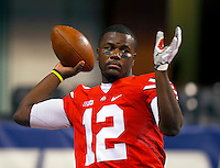Ohio State Buckeyes quarterback Cardale Jones (12) warms up before the Big Ten Championship game at Lucas Oil Stadium in Indianapolis on Saturday, December 6, 2014. (Columbus Dispatch photo by Jonathan Quilter)