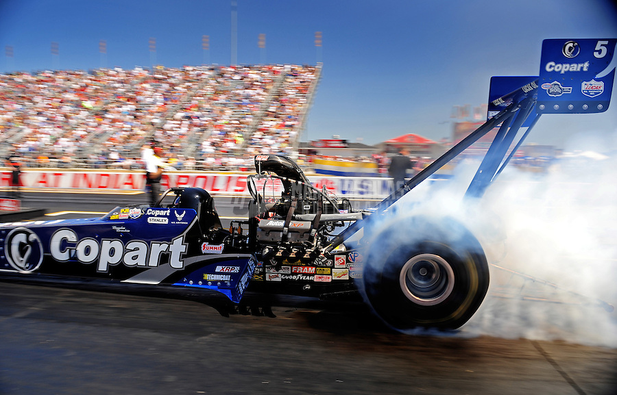 Sept. 5, 2010; Clermont, IN, USA; NHRA top fuel dragster driver Brandon Bernstein does a burnout during qualifying for the U.S. Nationals at O'Reilly Raceway Park at Indianapolis. Mandatory Credit: Mark J. Rebilas-