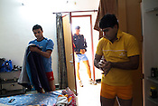 Members of the Indian Kabbadi team get ready in their room for a morning training session at a month long camp in Sport Authority of India Sports Complex in Bisankhedi, outskirts of Bhopal, Madhya Pradesh, India.