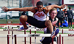 Edwardsville's Xavier McKenney leaps a hurdle in the first heat of the 110 meter hurdles. At right is Waterloo's David Broske who finished second in this heat at the Norm Armstrong Boys Track and Field Invitational on Wednesday April 11, 2018. Photo by Tim Vizer