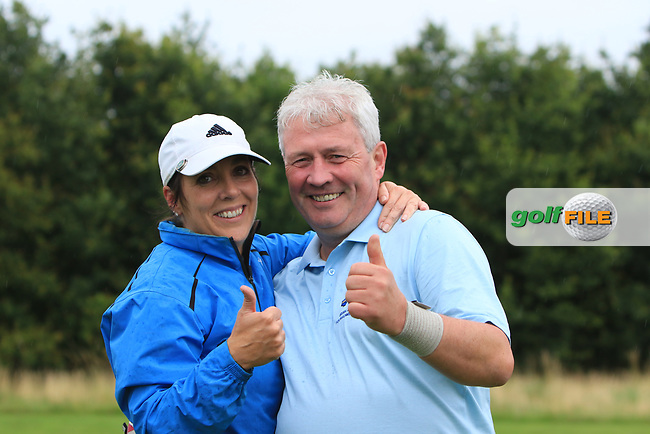 Eilish O'Connell and Martin Darcy (Tullamore) on the 15th green celebrating their victory during the Final round of the Irish Mixed Foursomes Leinster Final at Millicent Golf Club, Clane, Co. Kildare. 06/08/2017<br /> Picture: Golffile | Thos Caffrey<br /> <br /> <br /> All photo usage must carry mandatory copyright credit     (&copy; Golffile | Thos Caffrey)