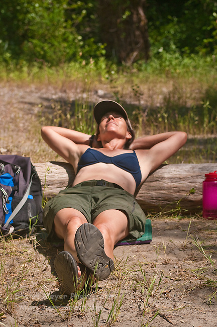 Hiker relaxing along the North Fork of the American River, Weimar, California.