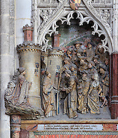 A kneeling donor and St Firmin entering Amiens, greeted by senator Faustinien, Gothic style polychrome high-relief sculpture from the funerary monument of Ferry de Beauvoir, 1490, in the first intercolumniation of the choir screen in the south ambulatory, depicting the life of St Firmin, at the Basilique Cathedrale Notre-Dame d'Amiens or Cathedral Basilica of Our Lady of Amiens, built 1220-70 in Gothic style, Amiens, Picardy, France. St Firmin, 272-303 AD, was the first bishop of Amiens. Amiens Cathedral was listed as a UNESCO World Heritage Site in 1981. Picture by Manuel Cohen