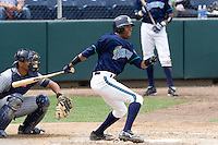 July 1, 2007: Outfielder Jermaine Brock of the Everett AquaSox makes contact with a pitch during a Northwest League game at Everett Memorial Stadium in Everett, Washington.