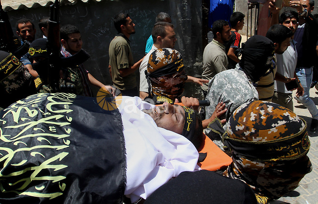 "Palestinian members of the Islamic Jihad's armed wing, the Al-Quds Brigades, carry the body of a fellow militant, Salah al-Astal, who died after a tunnel collapse in the Gaza Strip, during his funeral in Khan Younis in the southern Gaza Strip on July 19, 2016. The Al-Quds Brigades announced in a statement that Salah al-Astal had died during the ""collapse of a resistance tunnel,"" a term used by Islamic Jihad, Hamas and other Palestinian militant factions to refer to tunnels used in the conflict with Israel. Since January 26, at least 14 Gazans have been killed in at least seven separate tunnel collapses. Photo by Abed Rahim Khatib"