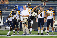 26 September 2009:  FIU wide receiver Greg Ellingson (82) attempts to haul in a Paul McCall pass as Toledo cornerback Daxton Swanson (5) defends in the first quarter of the Toledo 41-31 victory over FIU at FIU Stadium in Miami, Florida.