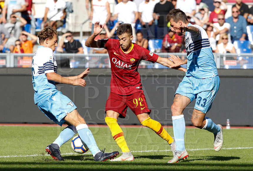 Roma's Stephan El Shaarawy, center, is challenged by Lazio's Lucas Leiva, left, and, Francesco Acerbi during the Italian Serie A football match between Roma and Lazio at Rome's Olympic stadium, September 29, 2018. Roma won 3-1.<br /> UPDATE IMAGES PRESS/Riccardo De Luca