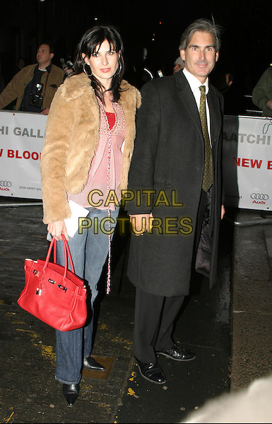 RONNI ANCONA.The Saatchi Gallery's first anniversary party at County Hall which coincides with the launch of new exhibition New Blood.23 March 2004.full length, full-length, fur jacket, denim jeans, red birkin handbag.www.capitalpictures.com.sales@capitalpictures.com.© Capital Pictures.