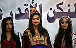Palestinian women wearing traditional dress creation take part during a fashion show marking Traditional Palestinian Dress Day, in the West Bank city of Nablus on August 22, 2017. Photo by Ayman Ameen