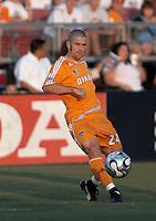 Houston Dynamo defender Wade Barrett passes the ball. New England Revolution beat Houston Dynamo 1-0 at Robertson Stadium in Houston, TX on May 19, 2007.