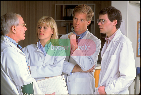doctors in lab coats consulting
