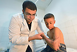 Dr. Khalid Abu Ajwa examines the scarred arm of 9-year old Zacaria Syam in the Al Ahli Arab Hospital in Gaza City. The boy was severely injured in an Israeli bombing during the 2014 war in Gaza. Ten family members died in the attack, including his mother. Because of the Israeli blockade of Gaza, the physician says the family cannot obtain a medicine that needed to treat the scars.<br /> <br /> The Anglican Church-affiliated hospital is a member of the ACT Alliance.<br /> <br /> The 2014 war provoked serious damage to Gaza's health infrastructure. Seventeen hospitals, 56 primary health care facilities and 45 ambulances were damaged or destroyed. Sixteen health care workers were killed and 83, most of them ambulance drivers and volunteers, were injured. <br /> <br /> Parental consent obtained.