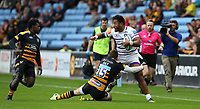 Leicester Tigers' Manu Tuilagi is tackled by Wasps' Elliot Daly <br /> <br /> Photographer Stephen White/CameraSport<br /> <br /> Gallagher Premiership - Wasps v Leicester Tigers - Sunday 16th September 2018 - Ricoh Arena - Coventry<br /> <br /> World Copyright &copy; 2018 CameraSport. All rights reserved. 43 Linden Ave. Countesthorpe. Leicester. England. LE8 5PG - Tel: +44 (0) 116 277 4147 - admin@camerasport.com - www.camerasport.com