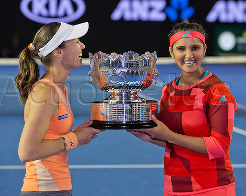 29.01.2016. Melbourne Park, Melbourne, Australia. Austalian Open Tennis Championship. Mens Semi Final Day. Marina Hingis and Sania Mirza celebrate with the trophy after winning the ladies doubles.