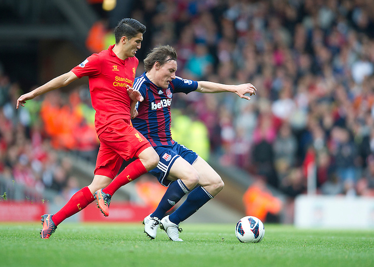 Stoke City's Dean Whitehead and Liverpool's Nuri Sahin ..Football - Barclays Premiership - Liverpool v Stoke City - Sunday 7th October 2012 - Anfield - Liverpool..