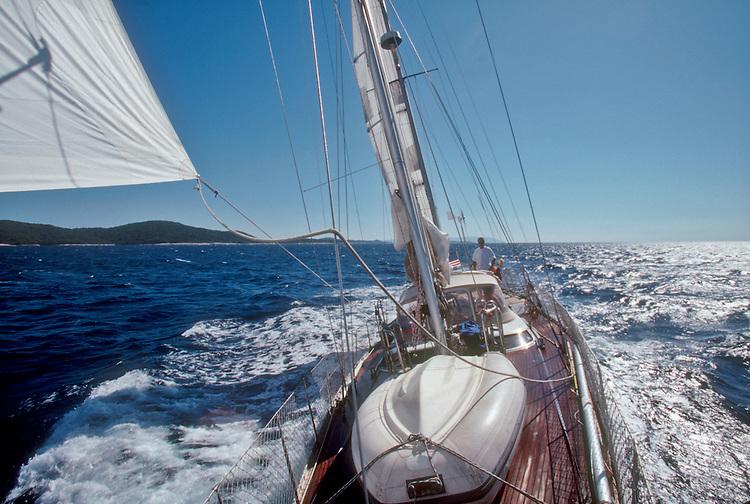 "Croatia, Sailing, Lastovski Channel, Mljet Island on left, Dalmatian Islands, Southern Dalmatia, Adriatic Sea, Europe, Ketch-rigged sailboat ""Lady Be Good"", Mark Hoffman at the helm, model released,.."